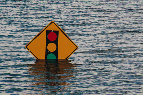 [Traffic sign in flood waters]