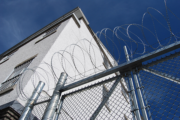 Barbed wire tops a fence at Kingston Penitentiary.