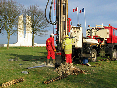 Workers drilling holes in chalk search for new-surface WWI excavations,