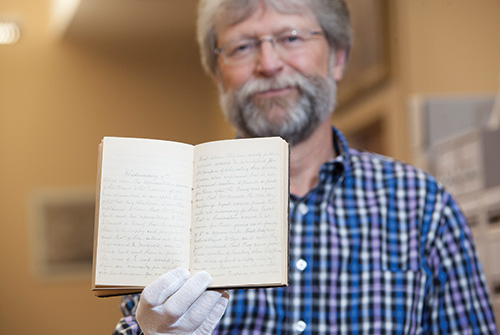 Queen's Archivist Paul Banfield with the MacMartin diary