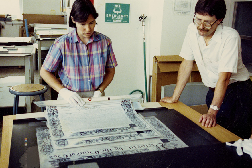 [Margaret Bignell and Paul Banfiedld examine the charter in this 1991 photo]