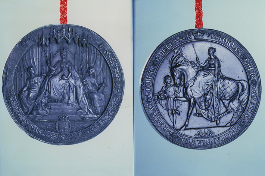 [A replica of the original seal attached to the Queen's royal charter]