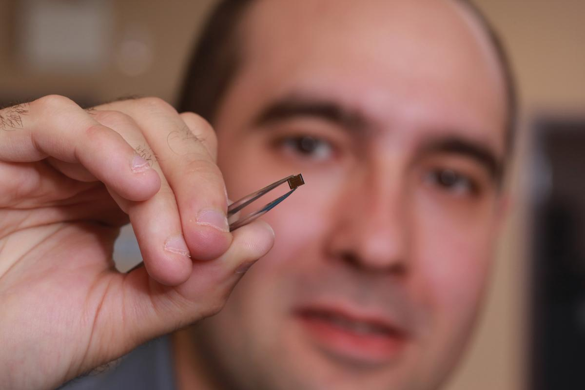 [photo of Marko Krstic holding a microchip]