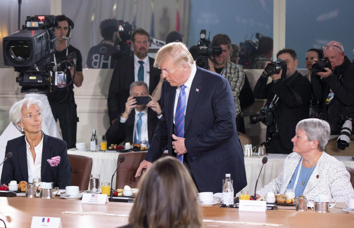 [CP Image: Christine Lagarde, Donald Trump, and Christine Whitecross at the G7 leaders summit June 9, 2018]