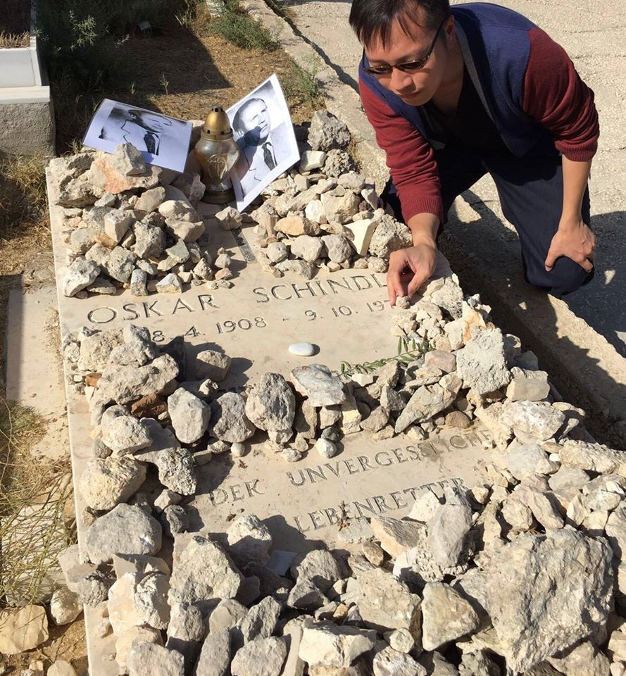 [photo of Simon Li at the gravesite of Oskar Schindler]
