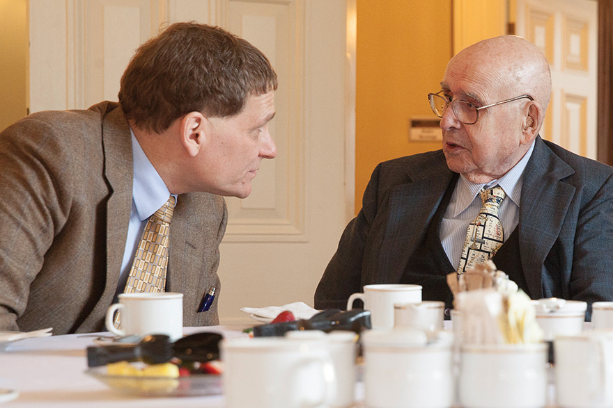 [photo of Principal Woolf and Alfred Bader at one of their teatime discussions, in 2014]