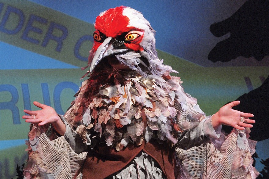 [photo of an actor in a bird costume]
