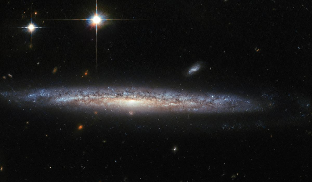 [photo of spiral galaxy 5714 taken by the Hubble Space Telescope]