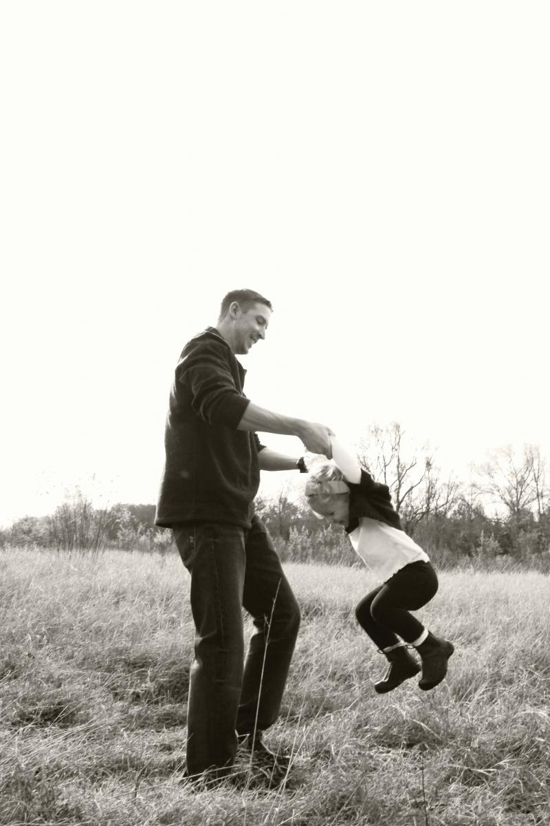 [photo of father and daughter playing]