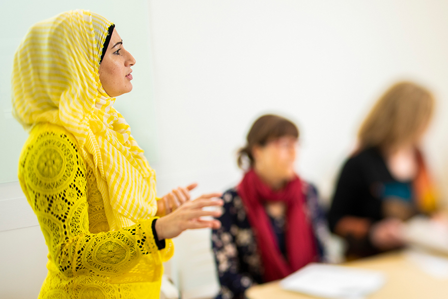[Photo of Dr. Roula Salam in discussion with students]