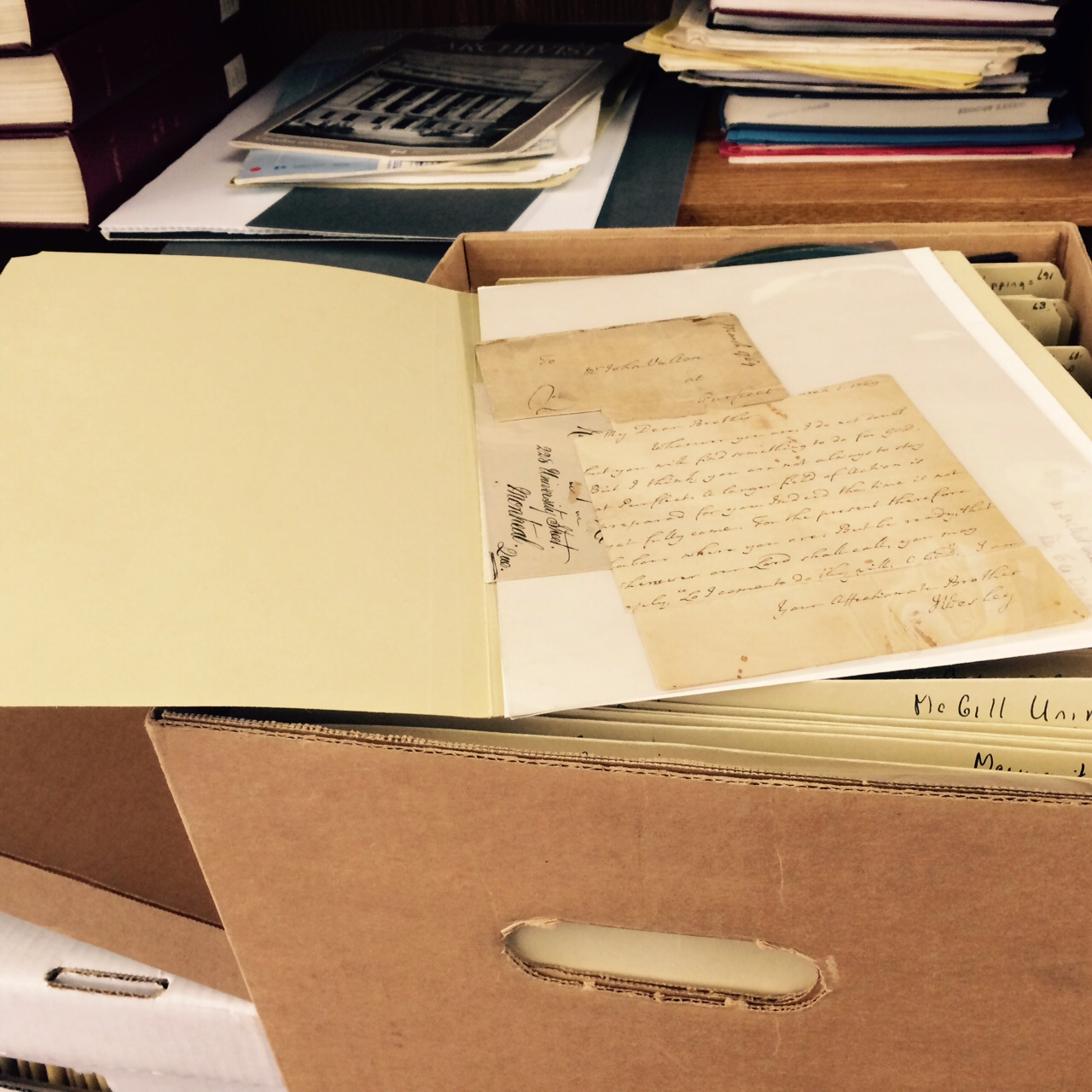 [photo of archival documents]