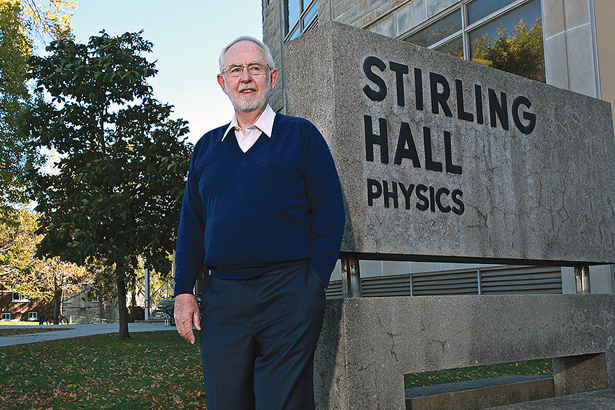 [photo of Arthur McDonald outside Stirling Hall at Queen's]