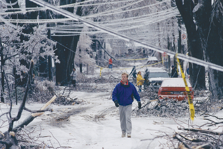 [photo of a man walking down a Kingston street after the 1998 ice storm]