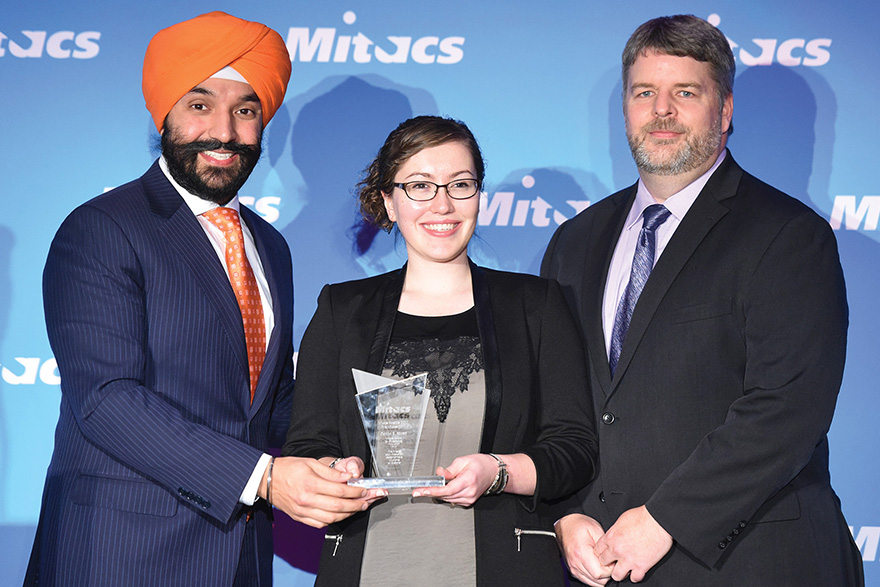 [photo of Caitlin Miron receiving an award from Navdeep Bains and Jim Banting]