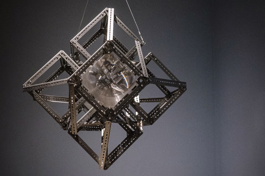 Jol Thoms, The Bulk: Frameworks, 2021, slotted steel angle with Fresnel lenses and mirror ball motor. Collection of the artist.