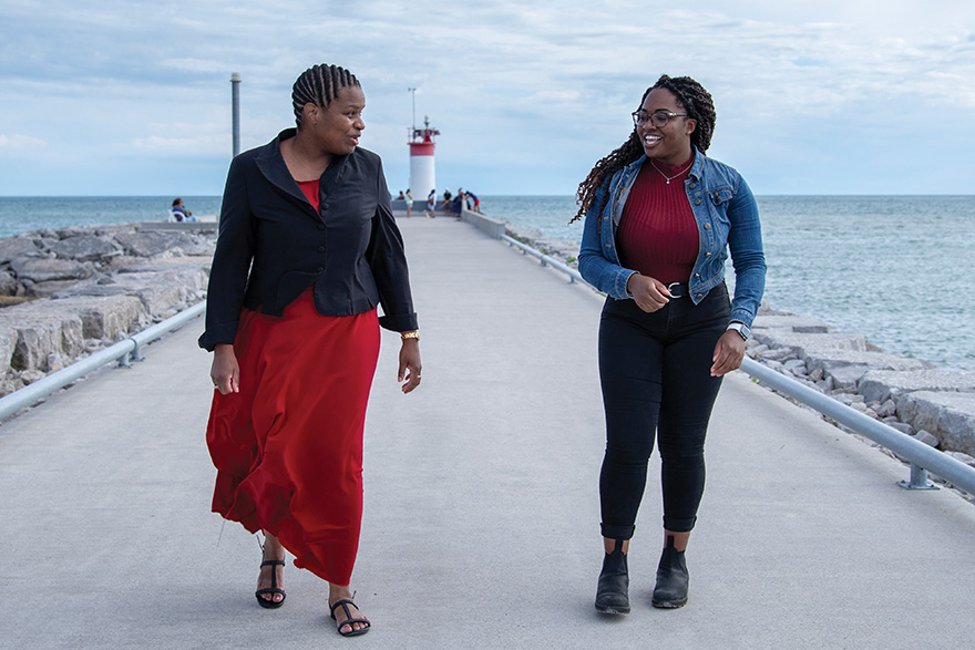 [photo of Rosalie Griffith and Aaliyah-Mae Hinds walking along a pier[
