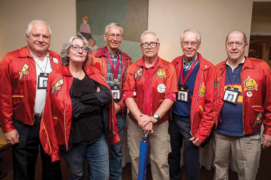[photo of editor Andrea Gunn with members of Arts'67]