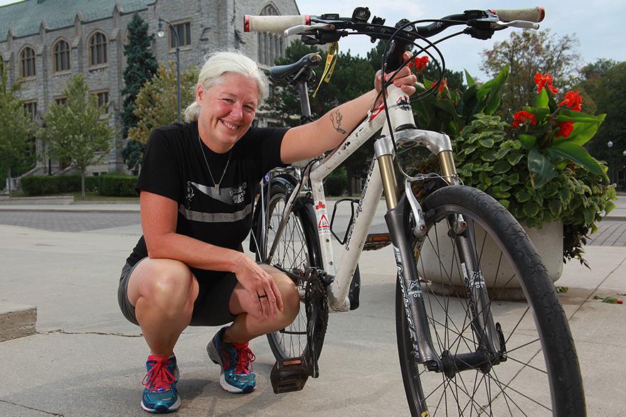 [Christine Buuc photowith bike]