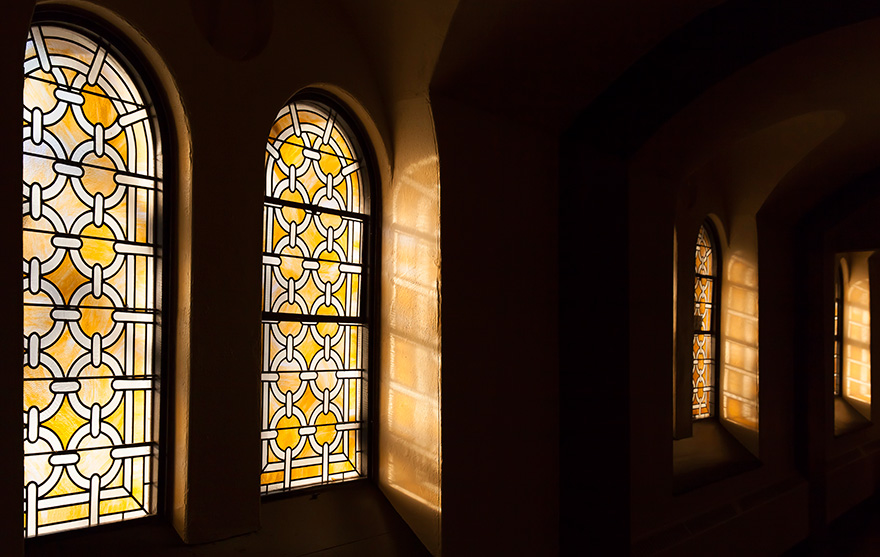 [photo of stained-glass windows in Grant Hall]