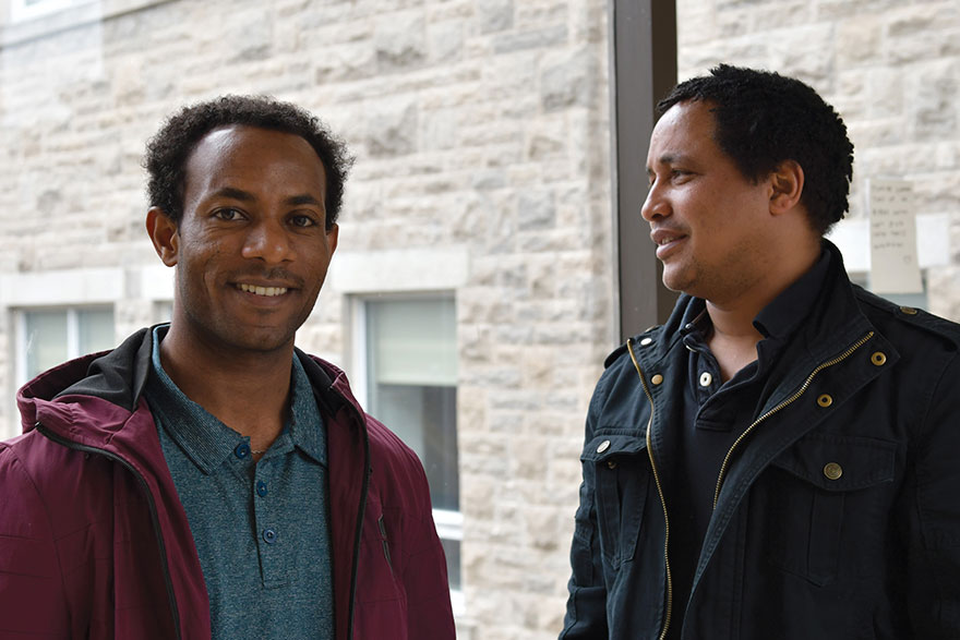 [photo of Mulugeta Chala and Molalign Adugna, doctoral students in the School of Rehabilitation Therapy.]