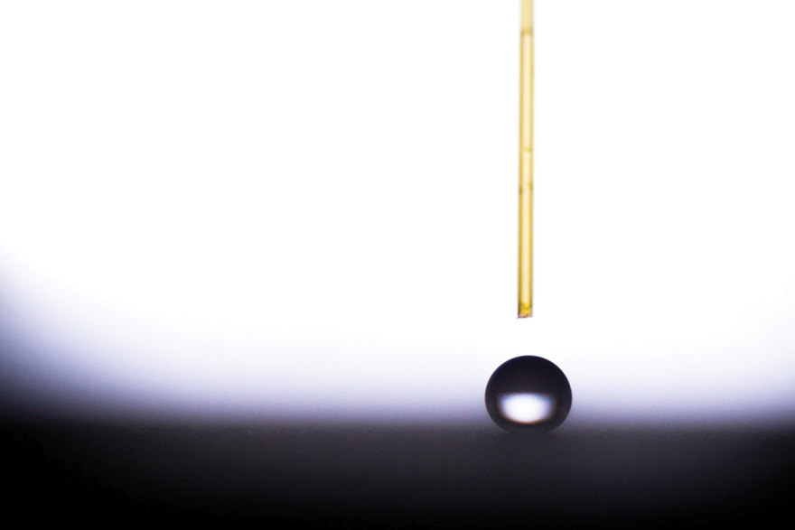[Photo of a drop of water on a superhydrophobic surface.]