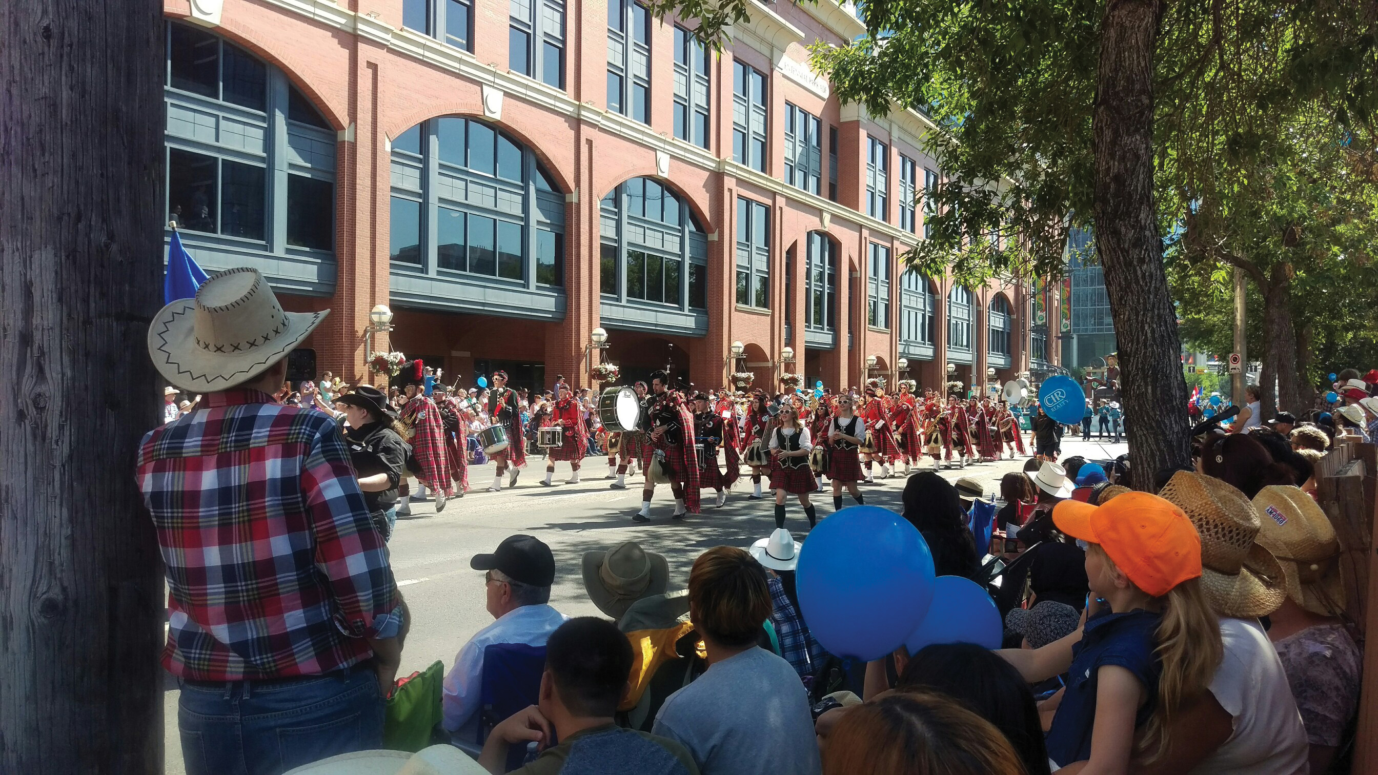 [photo of the Queen's Bands in Calgary]