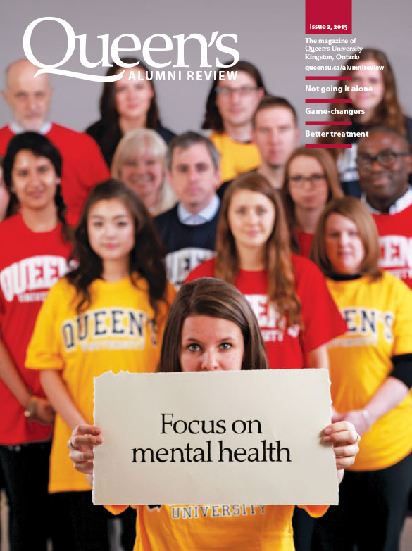 "[photo of Queen's staff, faculty and students with a sign ""Focus on mental health""]"