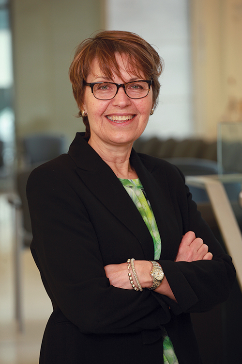 [photo of Dr. Terry Krupa: reducing stigma through social enterprise]
