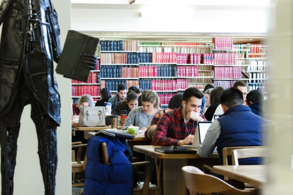 [Students working in library]