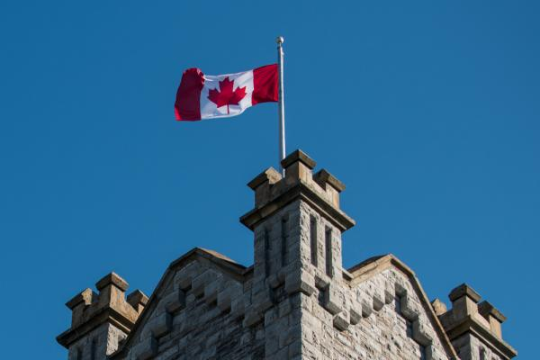Canadian flag flying atop a Queen's building