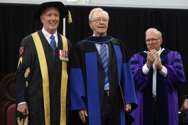 [Donald Sobey accepts honorary degree with Jim Leech and David Saunders]