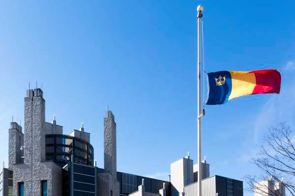 Flags lowered for retired staff member