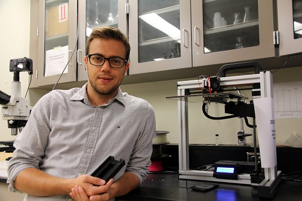 Matthias Hermann (MSc'17) poses with his invention – a device which detects cadmium in drinking water. (University Communications)