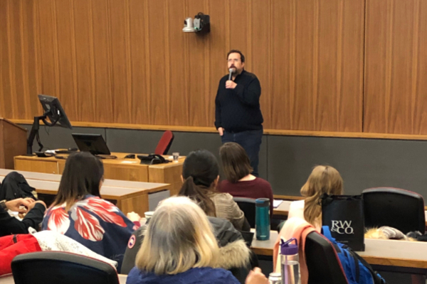 Evren Altinkas speaks to students at Queen's University.