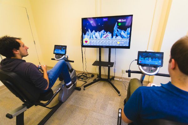 Members of Dr. Graham's lab demonstrate the exergaming system.
