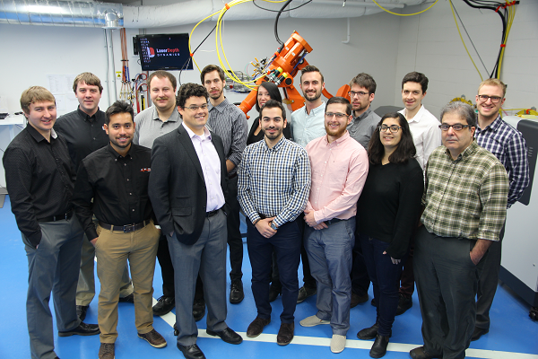 The Laser Depth Dynamics team, including chief technical officer and co-founder Paul Webster (Sc'06, PhD'13) (third from the left in the front row). (University Communications)