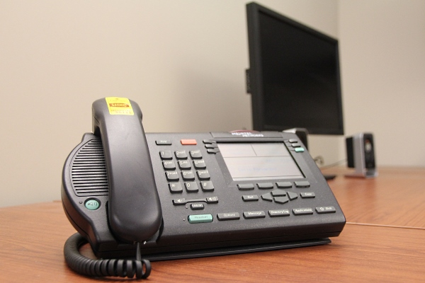 [Telephone on desk]