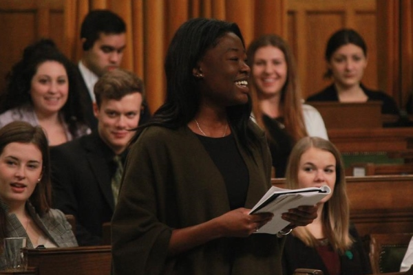 [Ashley Ansah speaking in House of Commons during Queen's Model Parliament 2016]