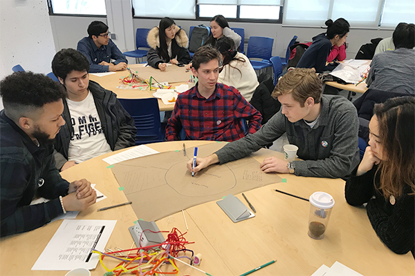 Students participating in Queen's Cares attend a workshop