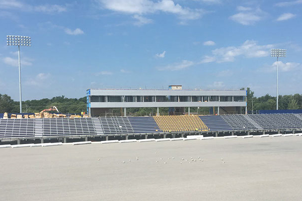 [Construction continues on new press box and west side grandstands]
