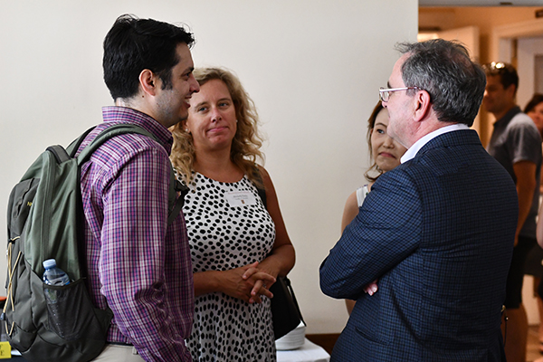 [Tom Harris speaks with new faculty members at a welcome event]