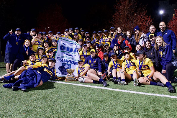 [Queen's women's rugby team celebrates OUA title]