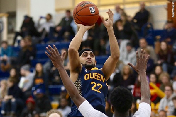 Jaz Bains puts up a shot in men's basketball