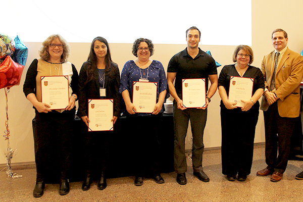"""Faculty and staff from the School of Medicine receive the Educational Technology Award, one of six Principal's Teaching and Learning Awards."""