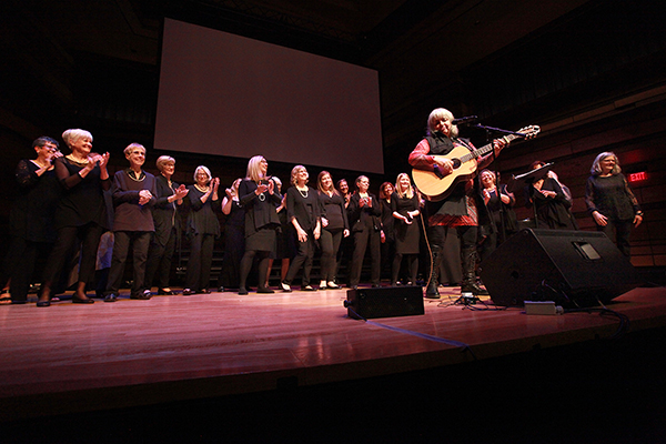 Lynn Miles performs with the She Sings Choir