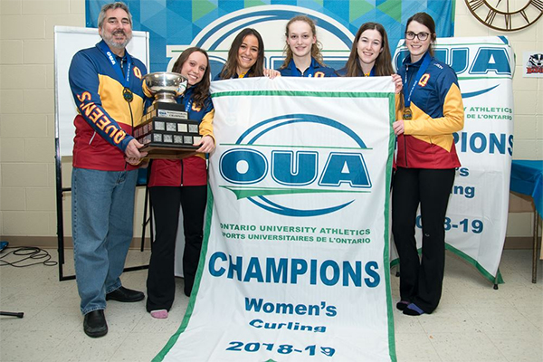 [Queen's Gaels women's curling team pose with the OUA banner and trophy]