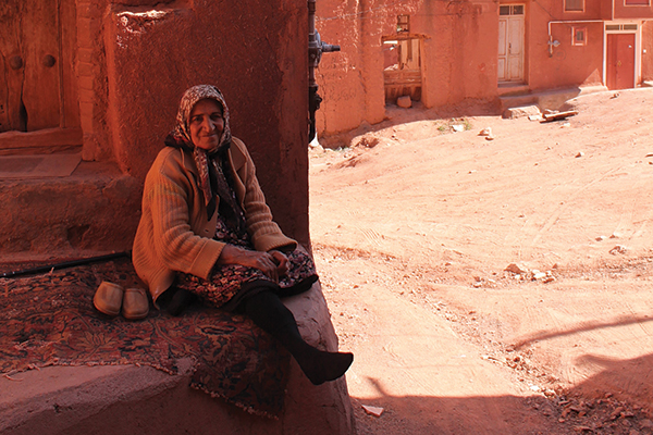 Ana Sofijanic's image of an Abyanaki woman as she escapes the midday sun, sitting in the shade of the old red clay houses that make up the village of Abyaneh.
