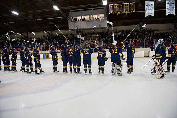 Queen's Women's hockey team lines up after OUA final