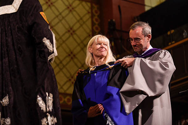 [Fiona Sampson is hooded by Dean Bill Flanagan]