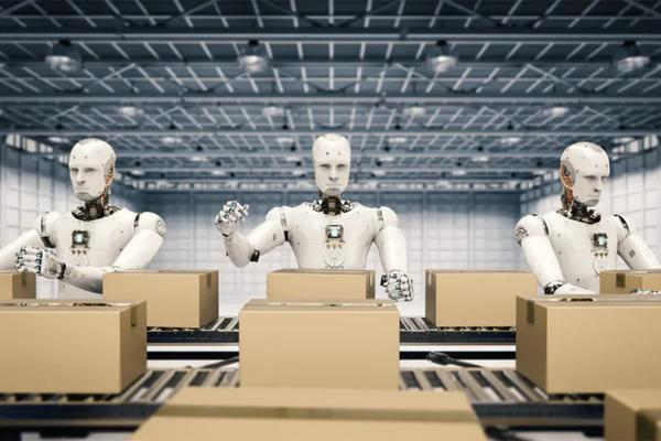 Three robots build boxes on an assembly line